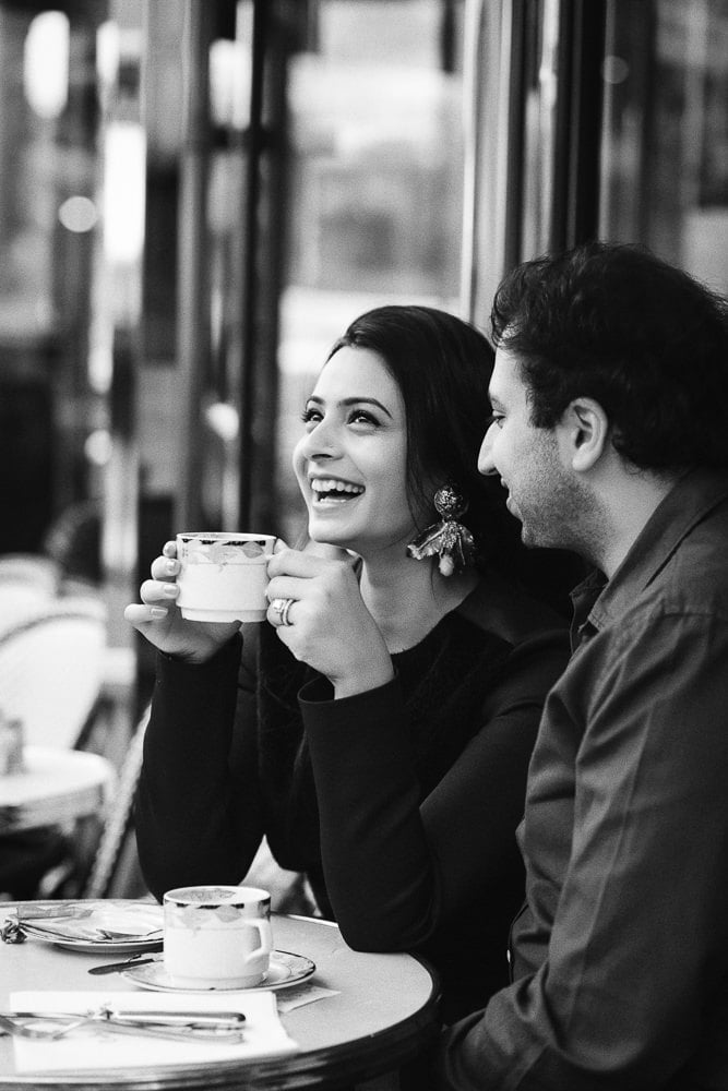 best photos of couples indian girl laughing with coffe in her hands