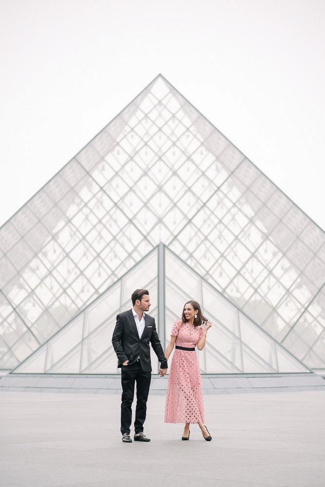 pictures for couples for engagement at the Louvre Museum Pyramid