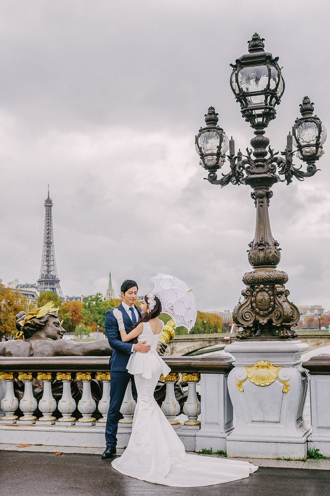 pre wedding photo shoot in paris on the alexander 2 bridge with bride and groom dancing