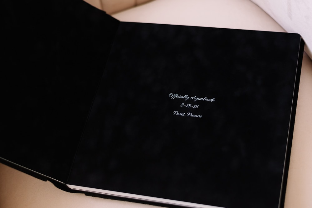 Details of personalized text on the first page of Paris photo album