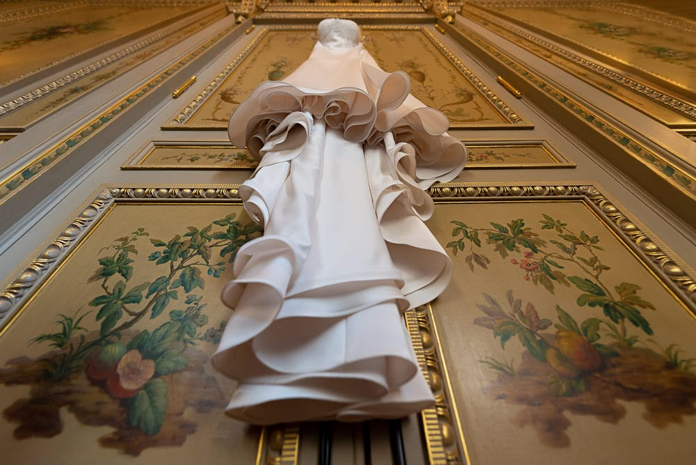 Hotel Crillon Paris wedding - designer wedding dress in luxurious hotel suite