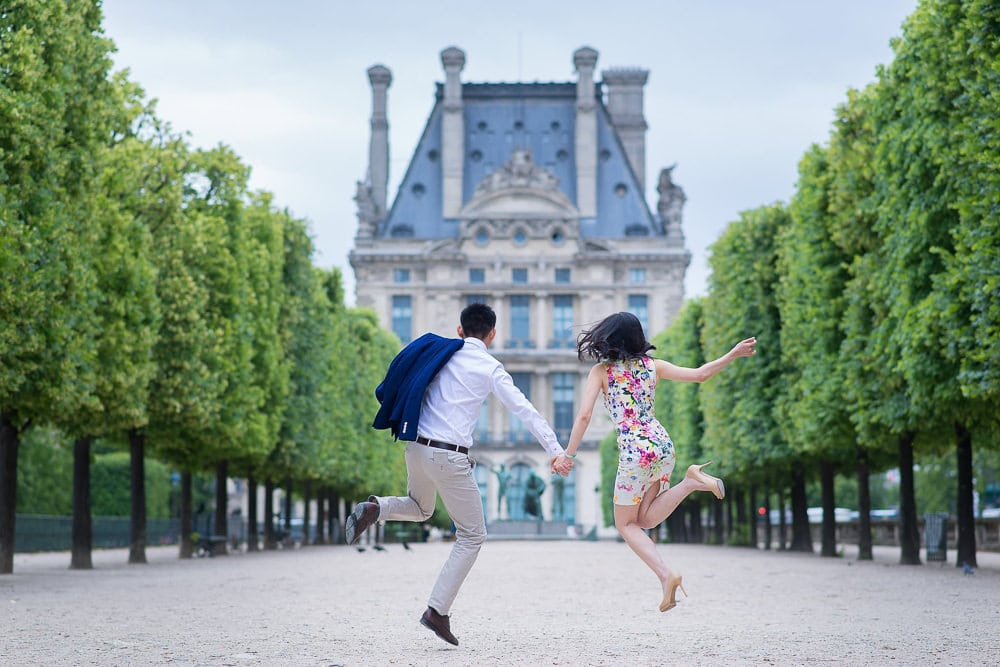 Couple jumping in the air in their fun photoshoot outfit