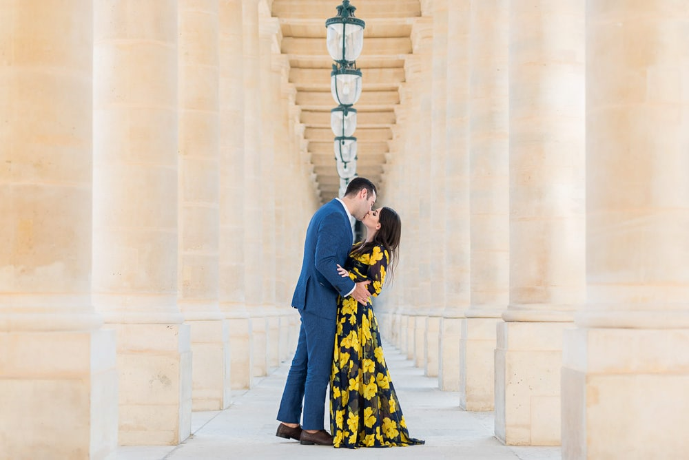 Photoshoot outfit option with yellow flowers flowy dress for her and blue suit for him
