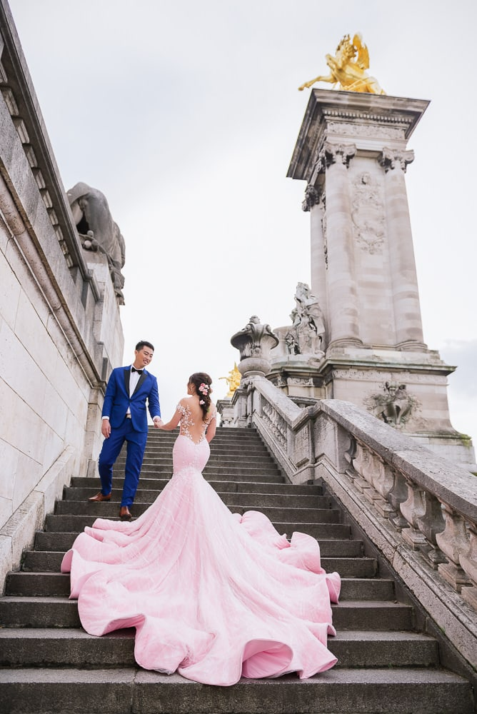 Asian bride with gorgeous big pink wedding dress posing for pre wedding photos in paris