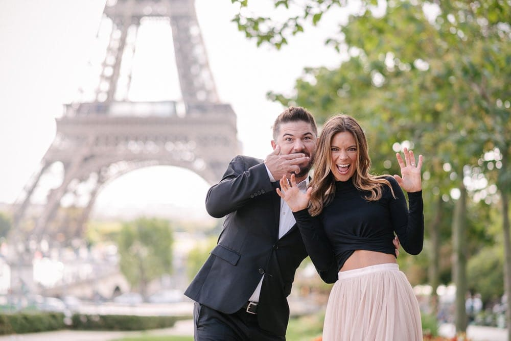 Fun photo of a couple at the Eiffel Tower