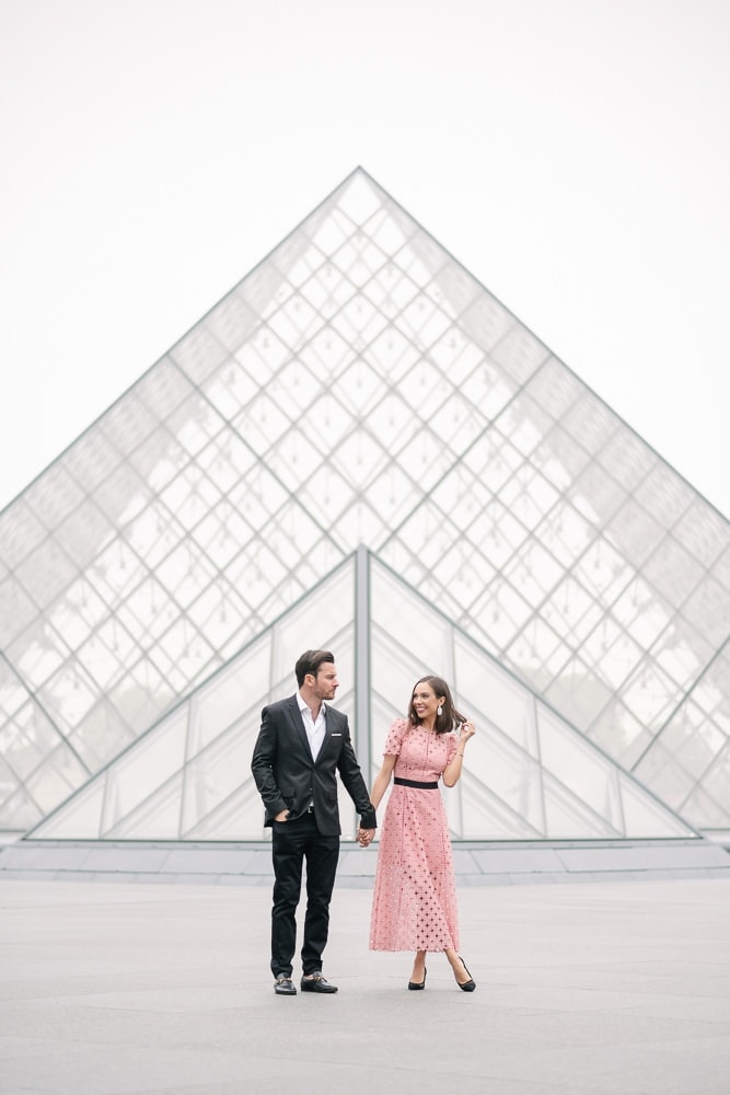 Posing ideas for couples - holding hands facing the camera and looking at each other