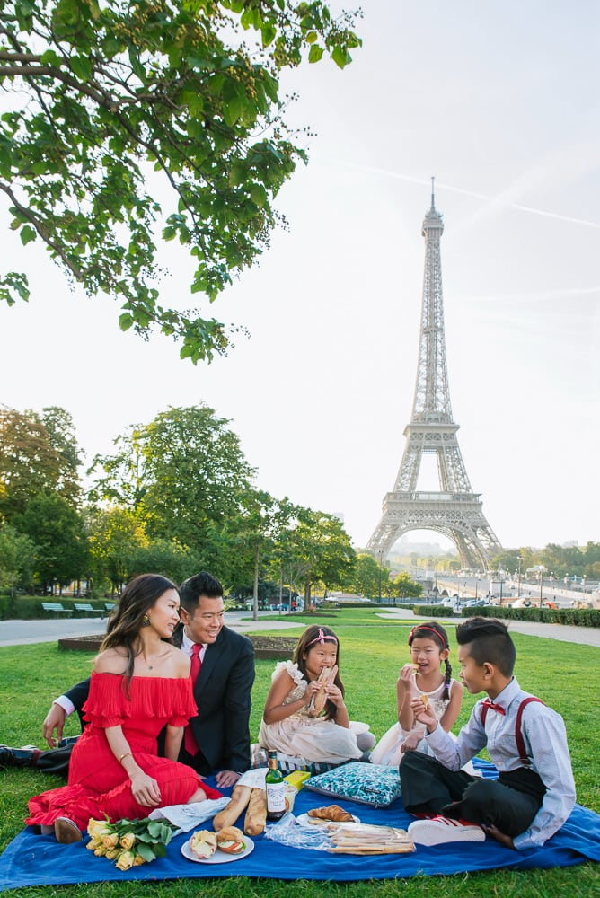picnic of beautiful family in paris by the eiffel tower
