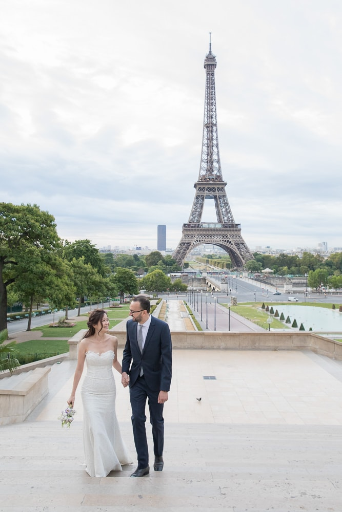 Romantic stroll for bride and groom by the Eiffel Tower