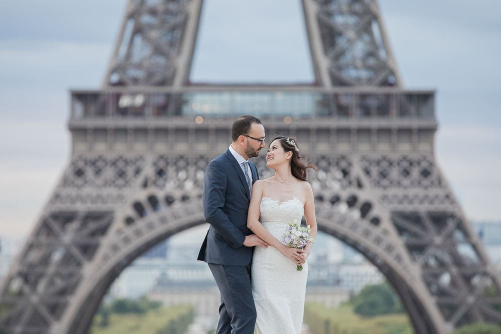 Bride and groom looking at each other during Paris photo shoot