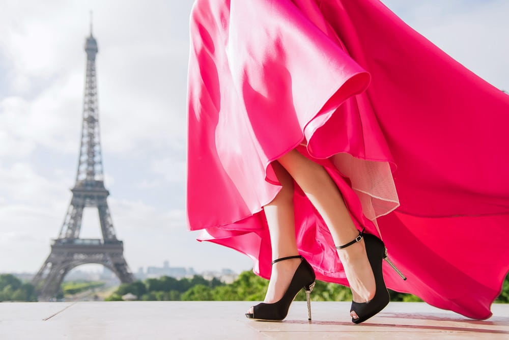 quinceanera picture ideas - shoes and dress close-up by the eiffel tower