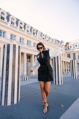 Fashionista posing for social media photos at Palais Royal