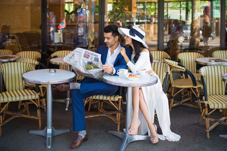 Honeymooning in Paris - Stylish couple on honeymoon in Paris enjoy coffee and newspaper