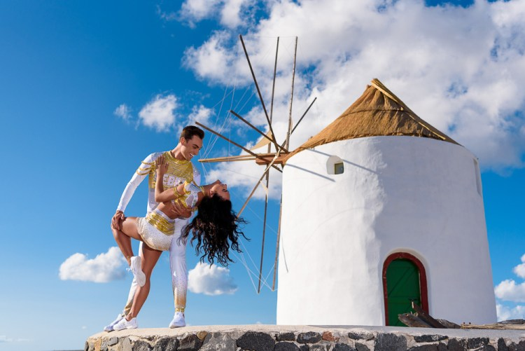 Cheer athletes in romantic pose during fashion photoshoot in Santorini Greeece