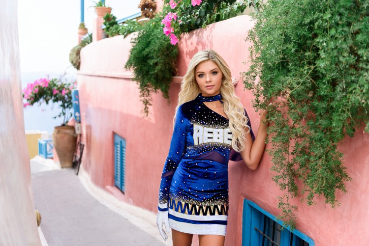 Cheerleading model posing for fashion photos in Santorini Greece