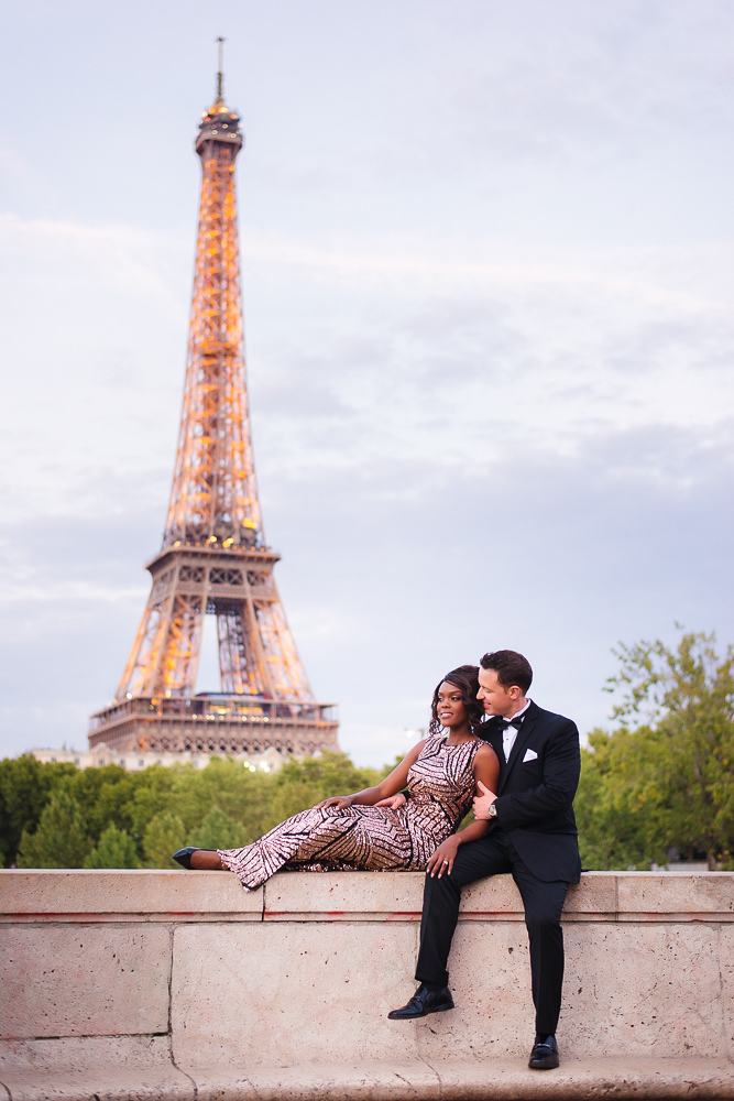 Romantic couple posing for photos by the Eiffel tower