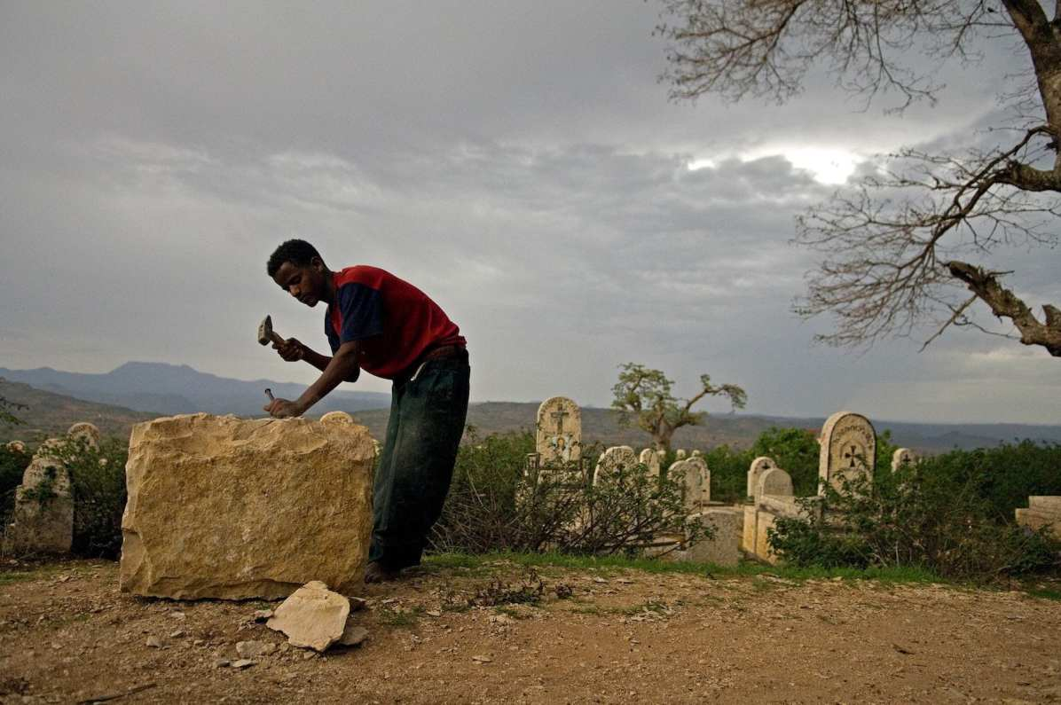 P18 At a cemetery near Harare, Ethiopia, Nega Wondimu chips away at what will eventually become a headstone. Ethiopia is one of the countries more severely affected by HIV/AIDS and the number of people currently living with HIV/AIDS in Ethiopia is estimated to be 1.5 million. The HIV prevalence in rural areas is 2.3%, as opposed to a prevalence of 13.2% in urban areas.