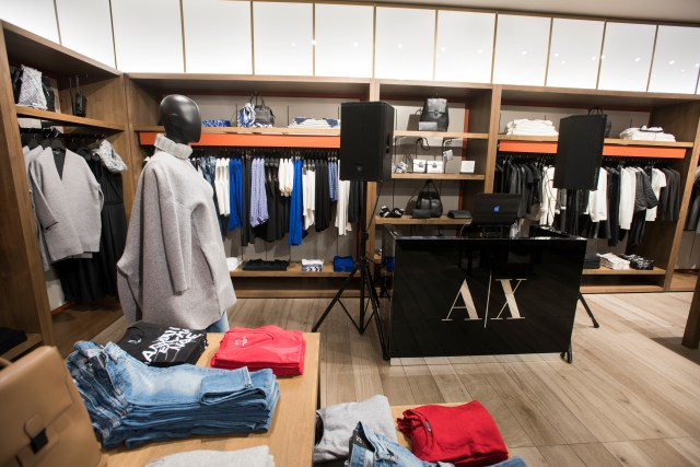 Guests enjoy the opening of the new Armani Exchange in Dallas, Texas on September 24, 2015.