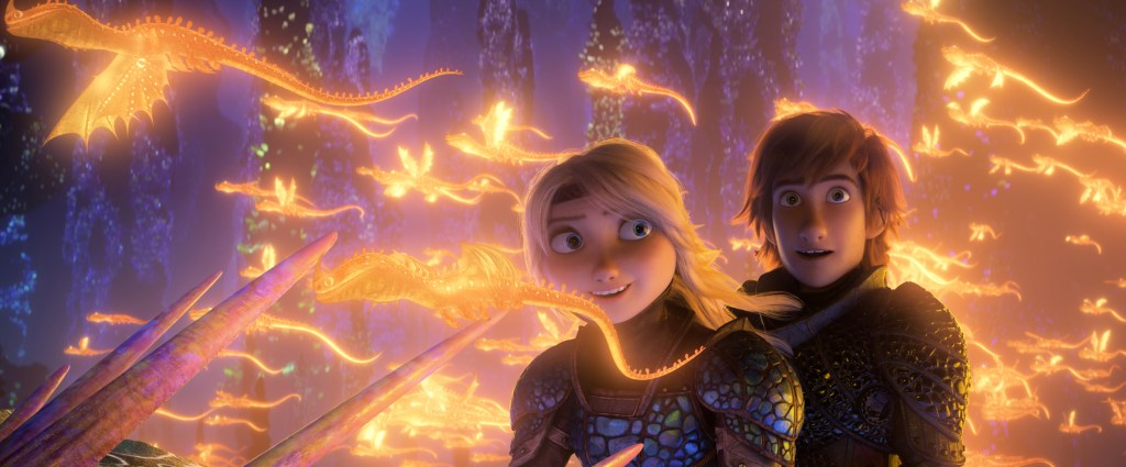Hiccup and Astrid riding a dragon among glowing dragons