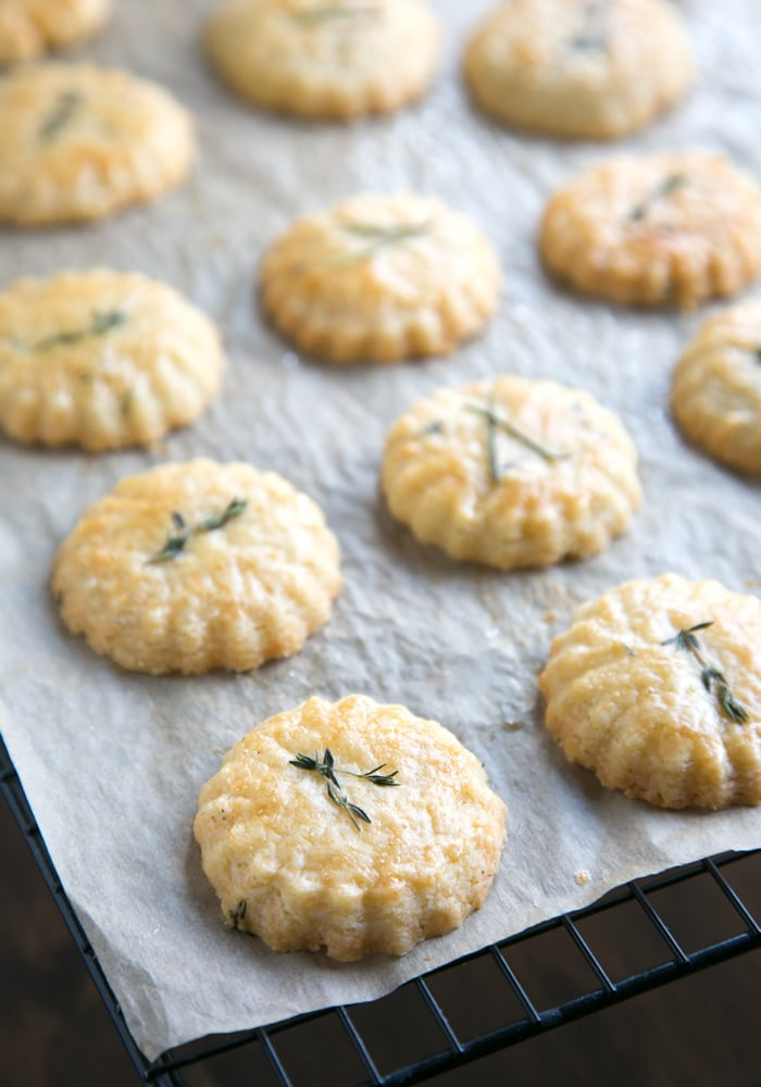 parmesan cookies on parchment paper and cooling rack
