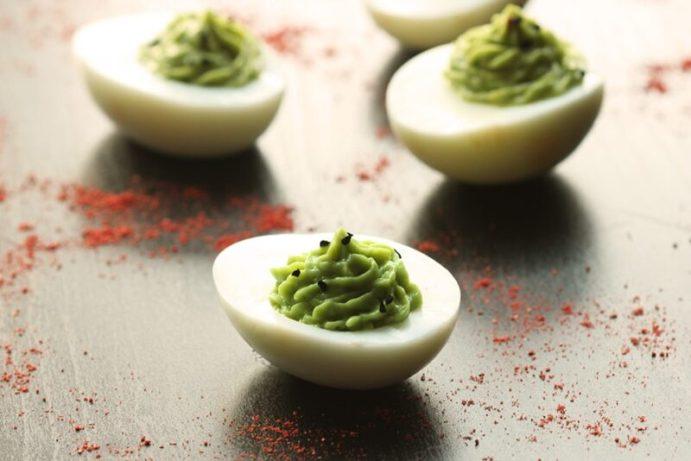 Chipotle Guacamole Deviled Eggs - The Egg-straordinary Easter Snack - thepetitecook.com