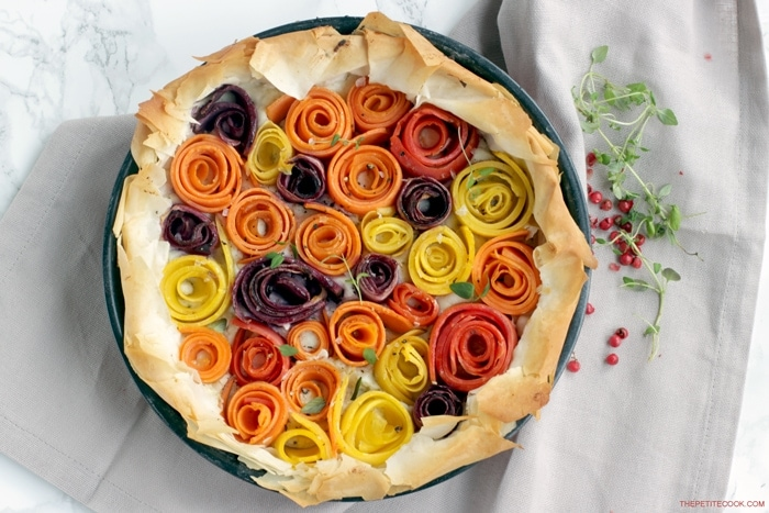This light and vibrant maple-glazed carrot phyllo tart is packed with seasonal rainbow carrots and fresh aromatic ricotta cheese - Ready in just 20 mins and 8 ingredients, it makes a showstopping vegetarian appetizer or main to share. Perfect for holiday parties! Recipe from thepetitecook.com