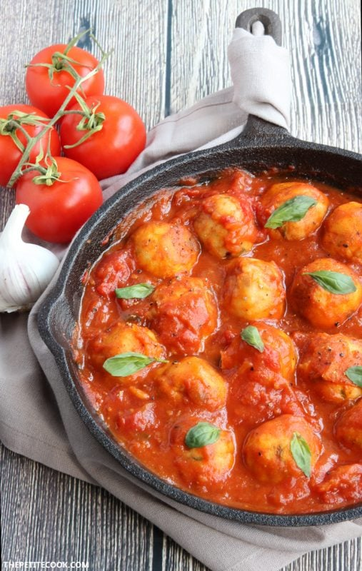 Sicilian Cod Meatballs make a delicious heathy family meal and are so easy to put together in just 30 min - Toss them with delicious homemade italian tomato sauce for authentic Mediterranean flavors delivered straight in your mouth! Gluten-free and dairy-free recipe from thepetitecook.com