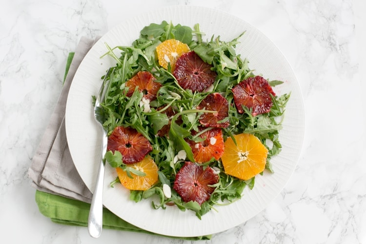 Brighten up your day with this gorgeous Blood Orange and Rocket Salad - Simple, vegan, gluten-free, packed with vibrant colors and so refreshing! Recipe by thepetitecook.com
