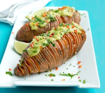 The easiest way to upgrade your typical baked potatoes. Crispy outside and fluffly melt-in-your mouth within, these Hasselback Sweet Potatoes with Guacamole make a great vegetarian spring or/and summer side! Recipe from thepetitecook.com