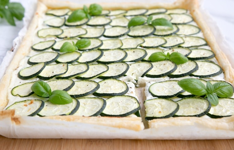 This rustic Zucchini Tart with Ricotta and Fresh Herbs makes a tasty vegetarian meal for any occasion - Ready in 30 mins and requiring just 5 ingredients, it's the perfect addition to any summer table! Recipe from thepetitecook.com