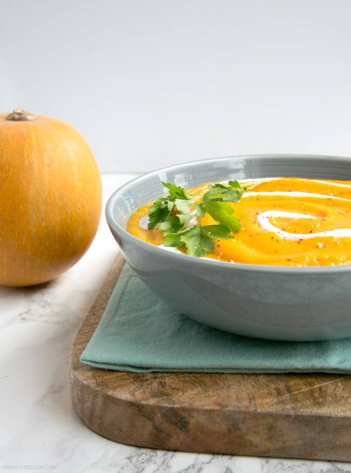 Delicately spicy, this heart-warming vegan, dairy-free and gluten-free Spicy Pumpkin and Carrot soup is wholesome, nutritious and perfect to welcome the fall season! Recipe from thepetitecook.com