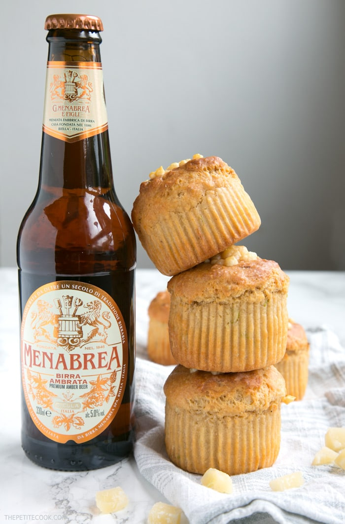 These Cheesy Parmesan Beer Muffins are a great grab-and-go snack or make-ahead lunchbox option - Super fluffy, packed with flavors, vegetarian and no butter or eggs required! Recipe from thepetitecook.com