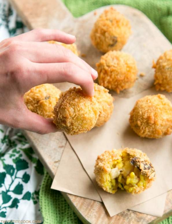 Crunchy and Cheesy Mushroom Arancini are great party material - The perfect seasonal italian snack for welcoming guests at your next holiday dinner party. They're vegetarian, with gluten-free option too! Recipe from thepetitecook.com