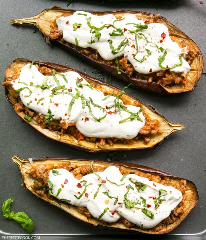 These lighten-up easy Moussaka Stuffed Eggplants bring a traditional Greek recipe to a whole new level - Easy to make, gluten-free and ready in just 30 min. Recipe by The Petite Cook thepetitecook.com