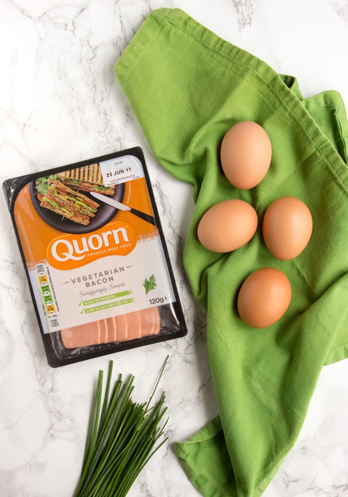 These fluffy and light Eggs In a Cloud make an impressive, yet simple, breakfast/brunch/light lunch in less than 15 minutes - Plus, they're loaded with protein and are naturally gluten-free and meat-free! Recipe by The Petite Cook - thepetitecook.com