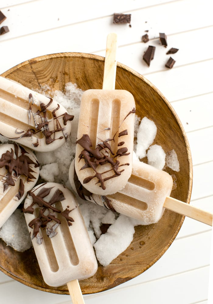 Healthy vegan Banana Chocolate Popsicles made with just 3 simple ingredients. Naturally dairy-free and gluten-free, they make the perfect summer treat to share! Recipe by The Petite Cook