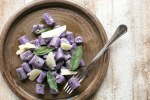 These Purple Potato Gnocchi with Sage and Butter are loaded with flavour - Soft pillowy purple potato gnocchi meet a velvety butter sauce and crunchy fragrant sage leaves to make a beautifully simple meal the whole family will be excited to dig in! Recipe by The Petite Cook