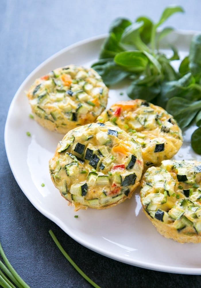 Veggie Omelet Muffins on a white plate with salad