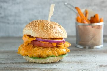 Buttermilk oven fried chicken burger with spicy mayo served with sweet potato fries