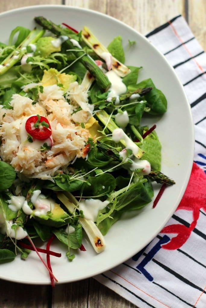 crab, avocado and greens salad in a bowl
