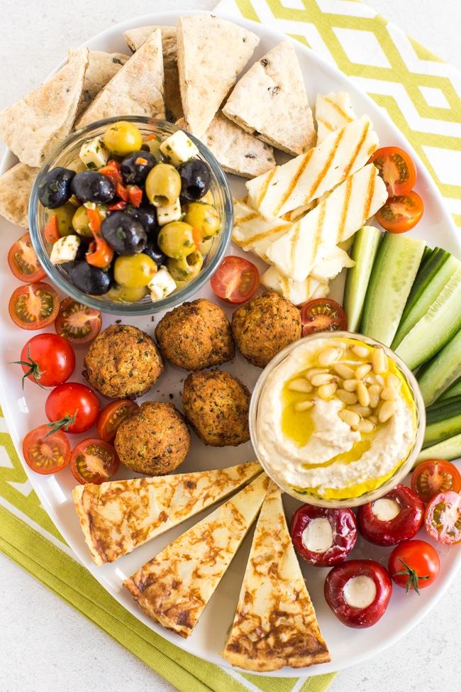 vegetarian mezze platter with pita, hummus, olives, falafel, veggies
