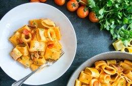 italian calamarata pasta with calamari and tomato sauce