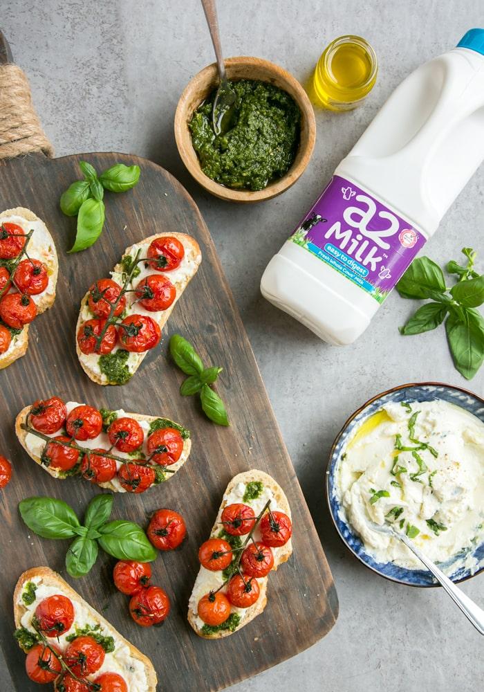 confit tomato bruschetta with ricotta and basil pesto, a2 milk bottle