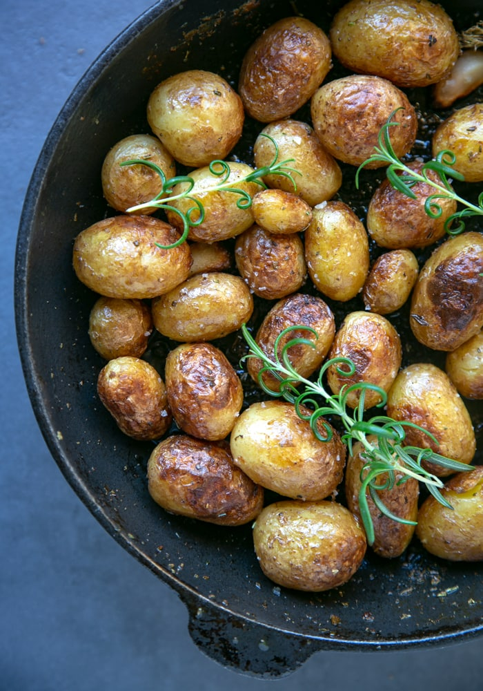 Italian pan roasted new potatoes with rosemary in skillet