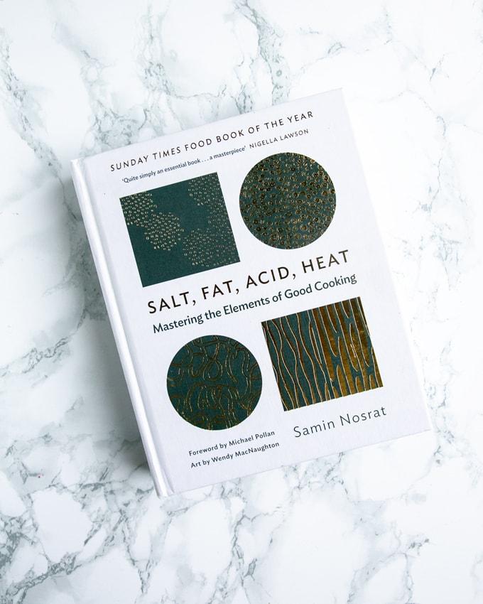 Foodie gift guide: salt, fat, acid, heat cookbook on marble background