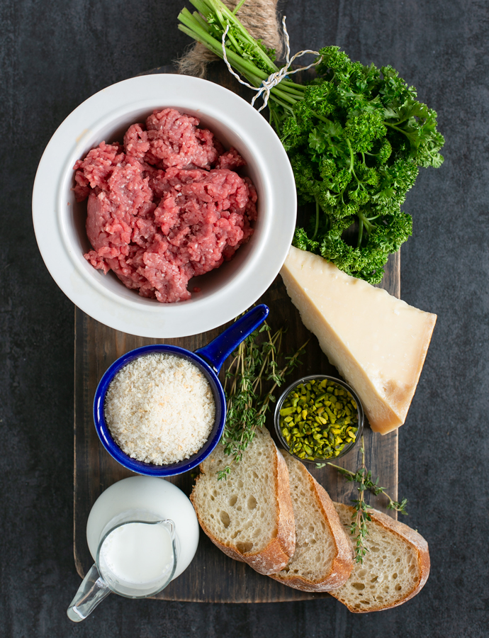 recipe ingredients: minced lamb, parsley, parmesan cheese, thyme leaves, bread slices, milk, panko breadcrumbs, chopped pistachios