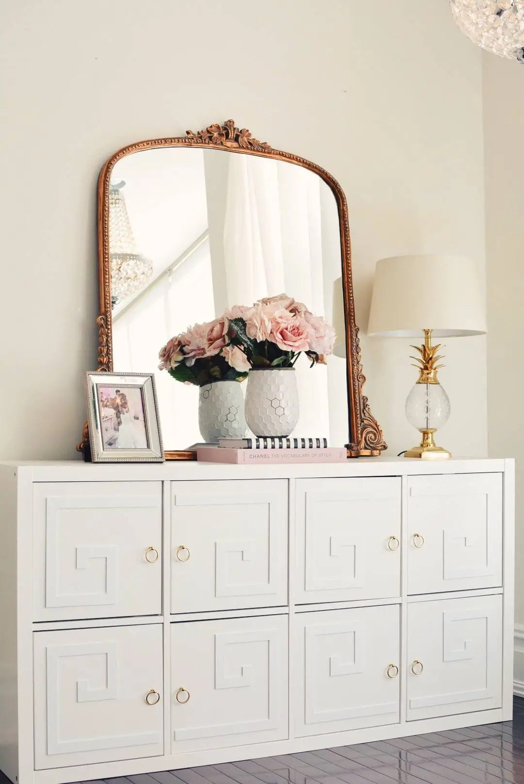 IKEA Kallax Hack to a pretty console table with overlay fronts and brass hardware. The Every Girl. #ikeahack #kallaxhack #kallax #diy #homedecor
