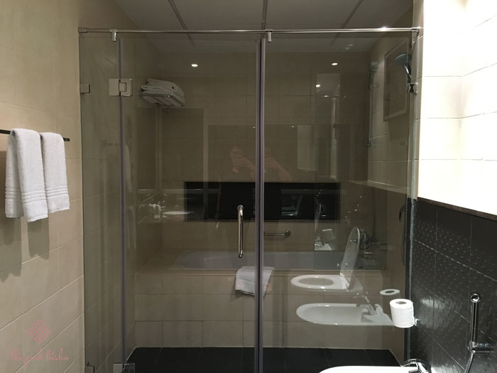 Bathrooms have separate tub and shower.