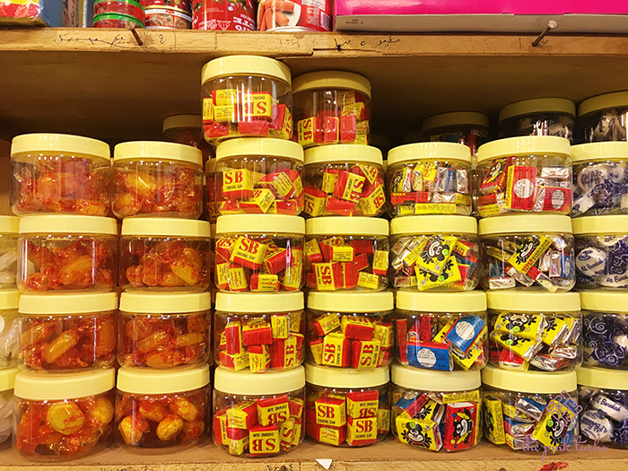 Candies and chocolates in plastic jars