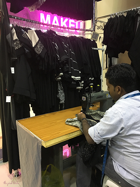 A tailor making adjustments to the abaya I bought.
