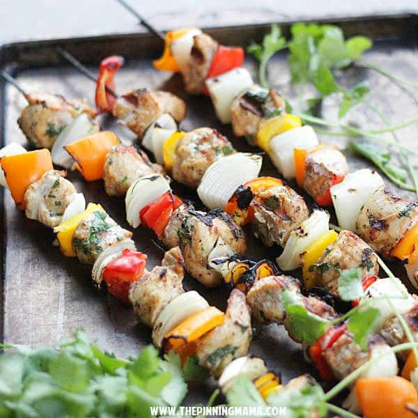 Paleo Fajita Kabobs on the grill. This is perfect for when we have company because everyone can customize their own!